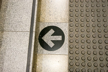 Printed arrow on floor direction to steps