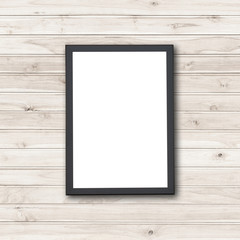 Blank of wooden photo frame on stone wall
