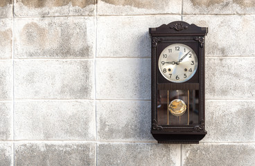 Antique wall clock with a pendulum