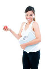 Happy Fitness Woman Holding Weigh Scale And Apple