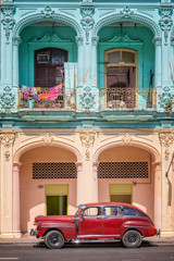 Classic vintage car and coloful colonial buildings in Old Havana, Cuba