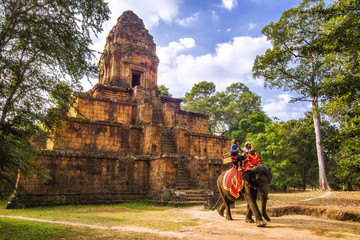 Tourists riding elephant at Angkor, Siem Reap, Cambodia.