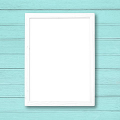 White blank picture frame on blue wood wall.