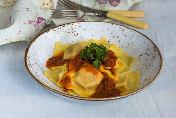 Italian ravioli with tomato sauce