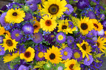 decorative sunflowers and blue asters