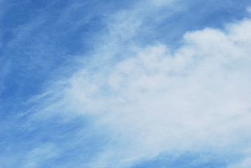 blue sky with abstract feathery clouds
