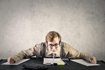 Nerd doing homeworks