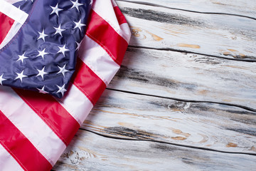 Crumpled flag of America. American flag on wooden background. Preserve the rights and freedoms. Land of great opportunities.