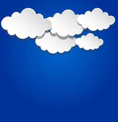 Paper clouds on blue background.