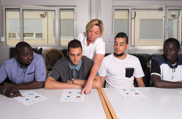 Language training for refugees in a German camp