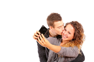 Happy couple taking a selfie on white background