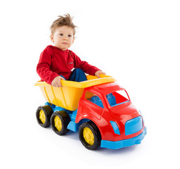 baby plays with truck