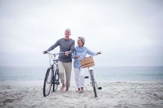 Senior couple having ride with their bike