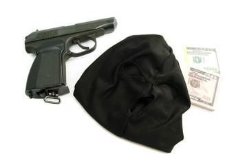 black mask, gun and dollars