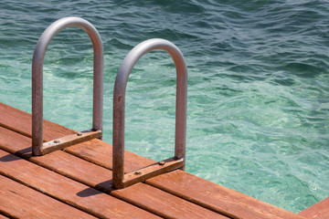 Dock stairs into the Caribbean in Belize