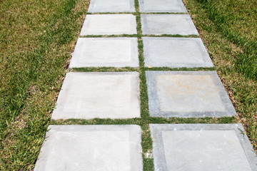 Path made from square pavers in grass
