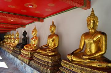 Golden and black buddha image