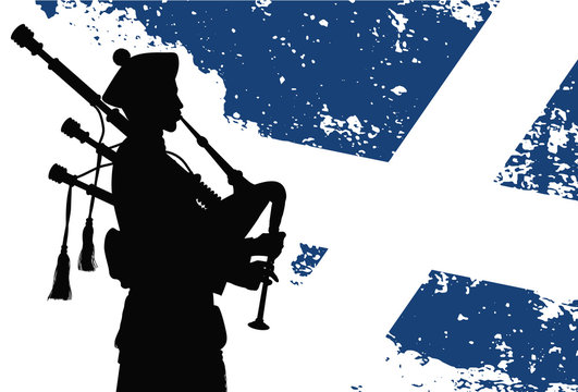 Silhouette of a bagpiper with Scottish flag on the background