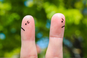 Finger art of couple. Couple after an argument looking in different directions.