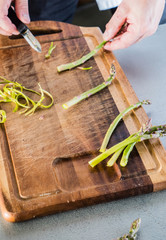 Trim and peel asparagus in the kitchen