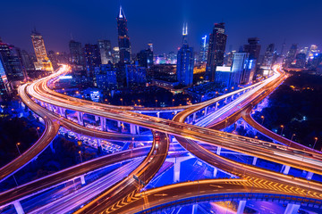 Spoed Fotobehang Nacht snelweg Aerial view of a highway overpass at night in Shanghai - China.