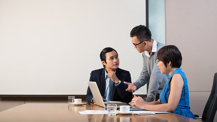 Young Asian business people having discussing in office