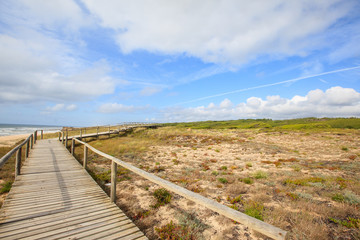 wooden walkway to the beach and ocean, Portugal