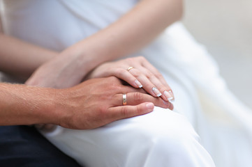 Male and female hand with rings