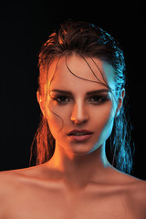 Wet girl with hair on her face looking straight