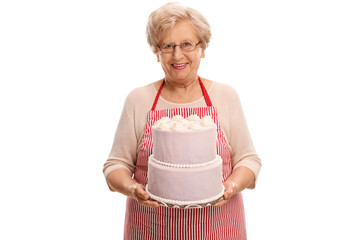 Mature lady holding a cake