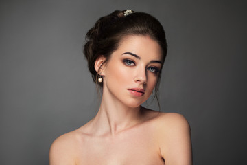 Beautiful sensual brunnete with elegant hairstyle. Wedding acces