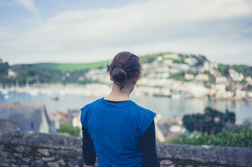 Young woman admiring view of seaside town