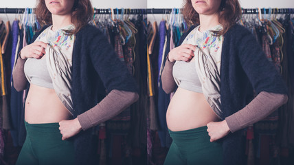 Young pregnant woman showing baby bump and trying to hide it