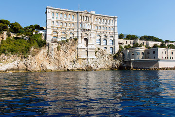 Monte Carlo harbor in Monaco with Cousteau Oceanographic Museum, as seen from the blue Mediterranean Sea. Horizontal with copy space for text