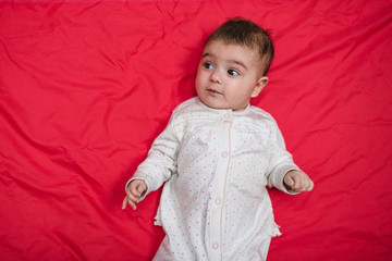 child on a red background