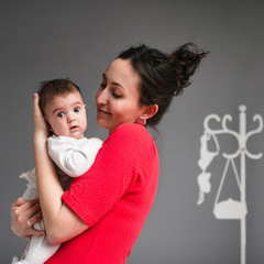 Mam holds baby in her arms