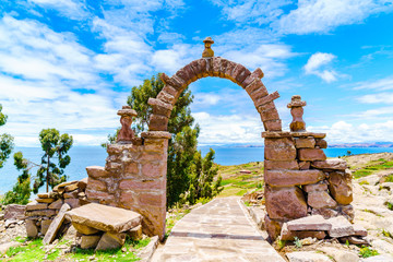 Stone arch leading to the main square of Taquile Island Wall mural