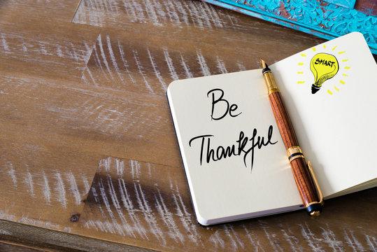 Handwritten text Be Thankful