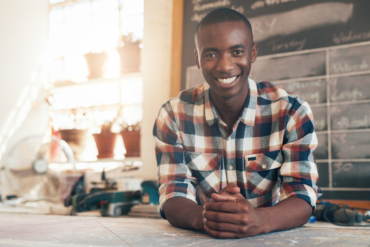 Proud African small busines owner in his beautifully lit studio