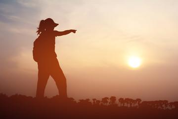 Silhouette women tourists.Background sunset