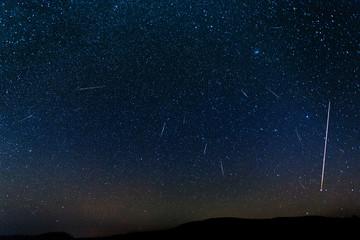 Perseid shower meteor activity.