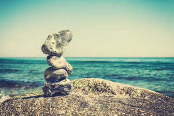 Vintage stylized stack of stones, shallow depth of field.