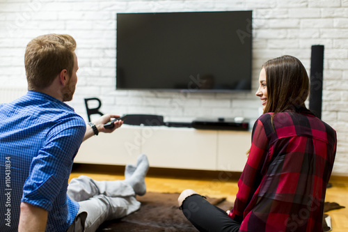 Quotcouple watching television sitting comfortably on floor for How to sit comfortably on the floor