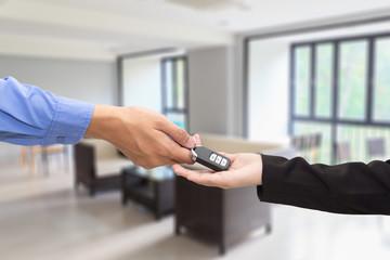 Buying Car. Businessman giving a key car to businesswoman