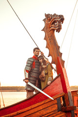 Couple of North princess and her beloved warrior on the bow of t