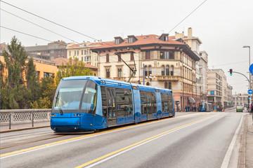 Blue tram on the street of Padua