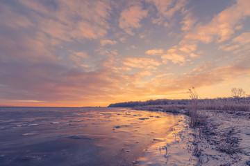 Sunrise over a frozen lake