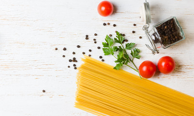 Dry spaghetti, white background. Free space for text . Top view