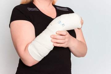 young female with broken hand in cast
