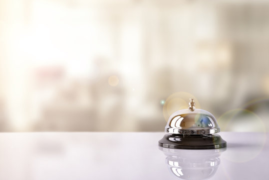 Service bell on hotel reception with Hotel background